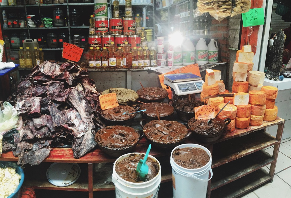 Zacapu market, front left to right: carne seca (jerkey), mole & fresh local cheeses