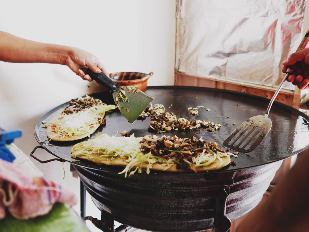Huaraches – a thick corn tortilla stuffed with beans and grilled, with mushrooms, salsa, cilantro & lettuce for garnish.