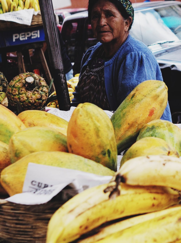 Woman selling papaya on the street in Xela
