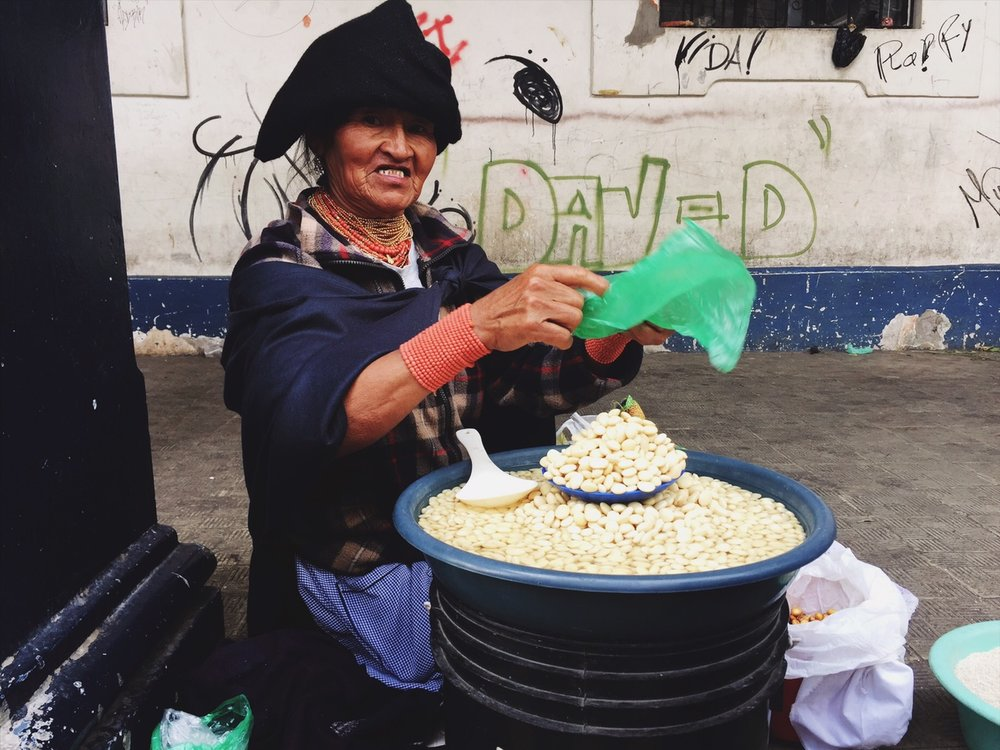 Purchasing legumes from a woman in Otavalo, Ecuador