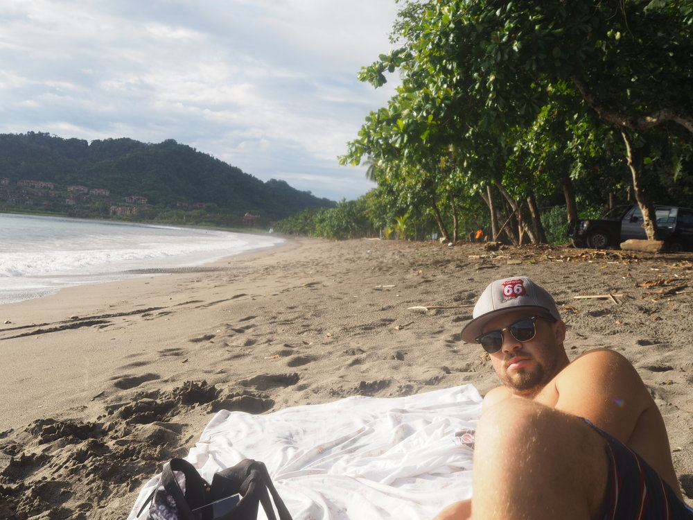 Kevin taking in some sun on Playa Herradura