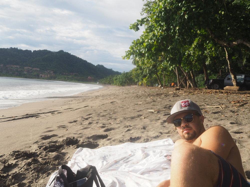 Kevin taking in some sun on Playa Herradura