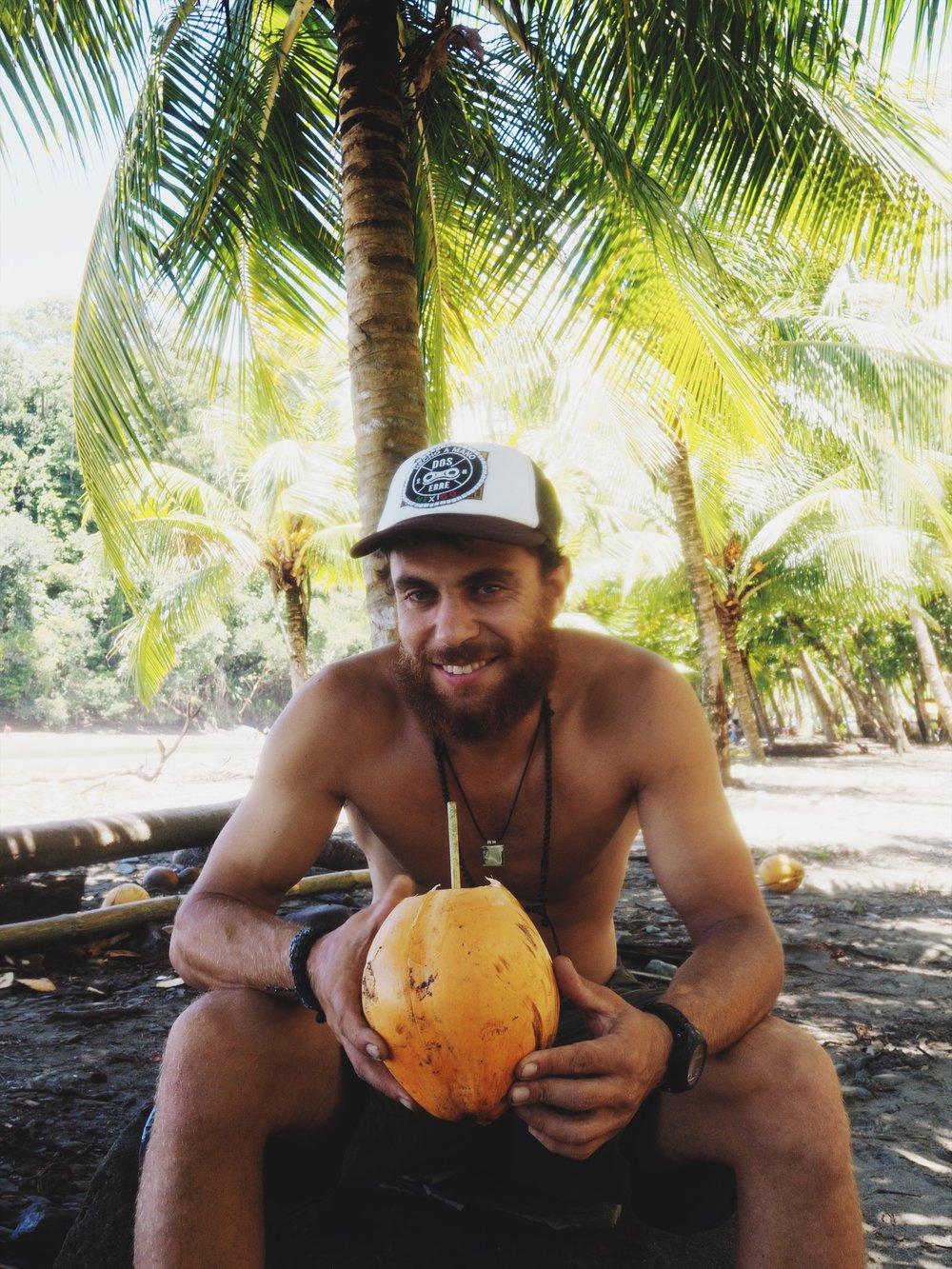 Enjoying coconut water straight from the source