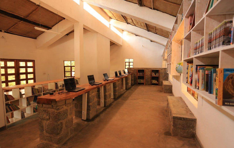 Inside the library. The computers and books are free for the community to use.