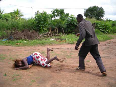 African Man Beating and Throwing Woman to ground.