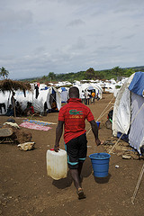 African Man Carrying Potable Water, Photo by Oxfam International