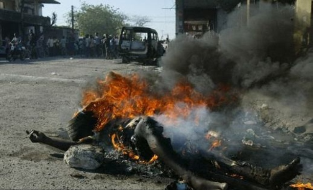 South African Man Killed by Necklacing, Photo by Sofolo