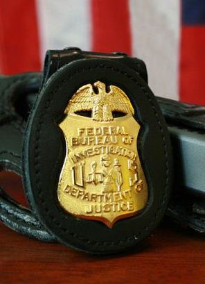 FBI Badge & Gun (Cropped), Source (Wikipedia)