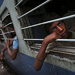 Indian Boy Waits on Powerless Train, Photo by Multimediapre