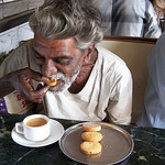 Old Man Eating, Photo by Shusthan N