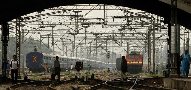 stranded-new-delhi-passengers-walk-train-tracks-photo-by-multimediapre.jpg