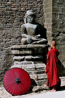 Buddhist Monk Standing Before Buddha, Photo by Ruro Photography