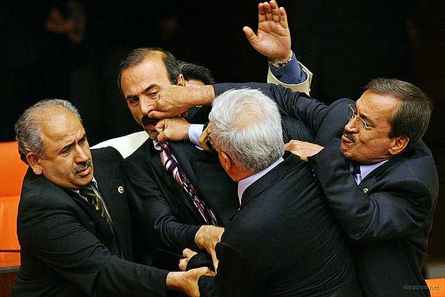 akp lawmakers fight in parliament, photo ap burhan ozbilliicj