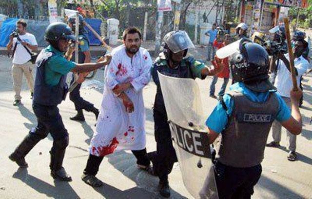bloody-bangladeshi-beaten-by-police-photo-by-protibadi-musafir.jpg