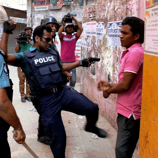Awami Police Kicking Protester in Bangladesh, Photo by Protibadi Musafir