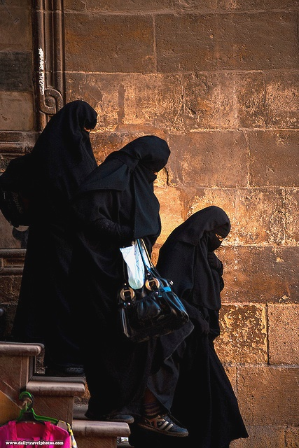 Muslim women in burqas navigate a set of stairs at the Al-Ghouri complex in Islamic Cairo