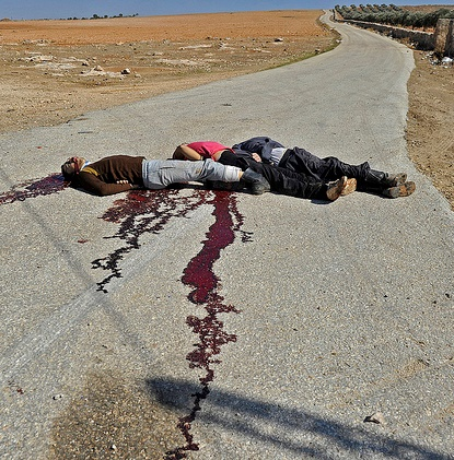 Dead Bodies Lie in Road in Retailiation for Rebel Killing of Soldier, Daraa Province, Aleppo, Syria, Photo by Peacock Almntouf