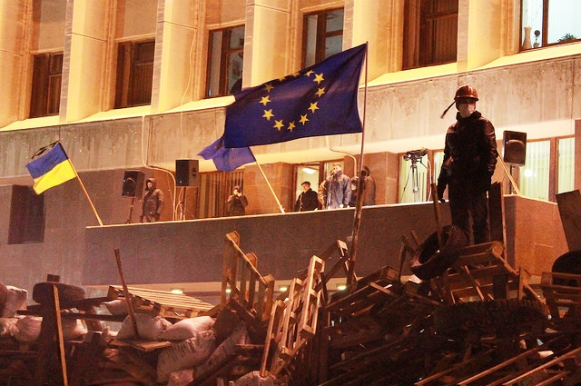 man-standing-on-barricade-regional-state-administration-building-kiev-ukraine-photo-by-pavlo-kuzyk.jpg