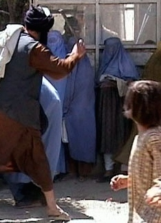 Taliban beating woman in public Photo by: RAWA