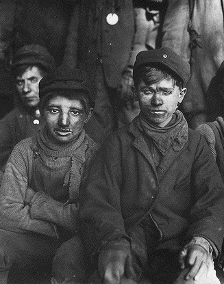 Group of breaker boys. Smallest is Sam Belloma. Pittston, Pa, January 1911, Photo by The U.S. National Archives (Cropped)