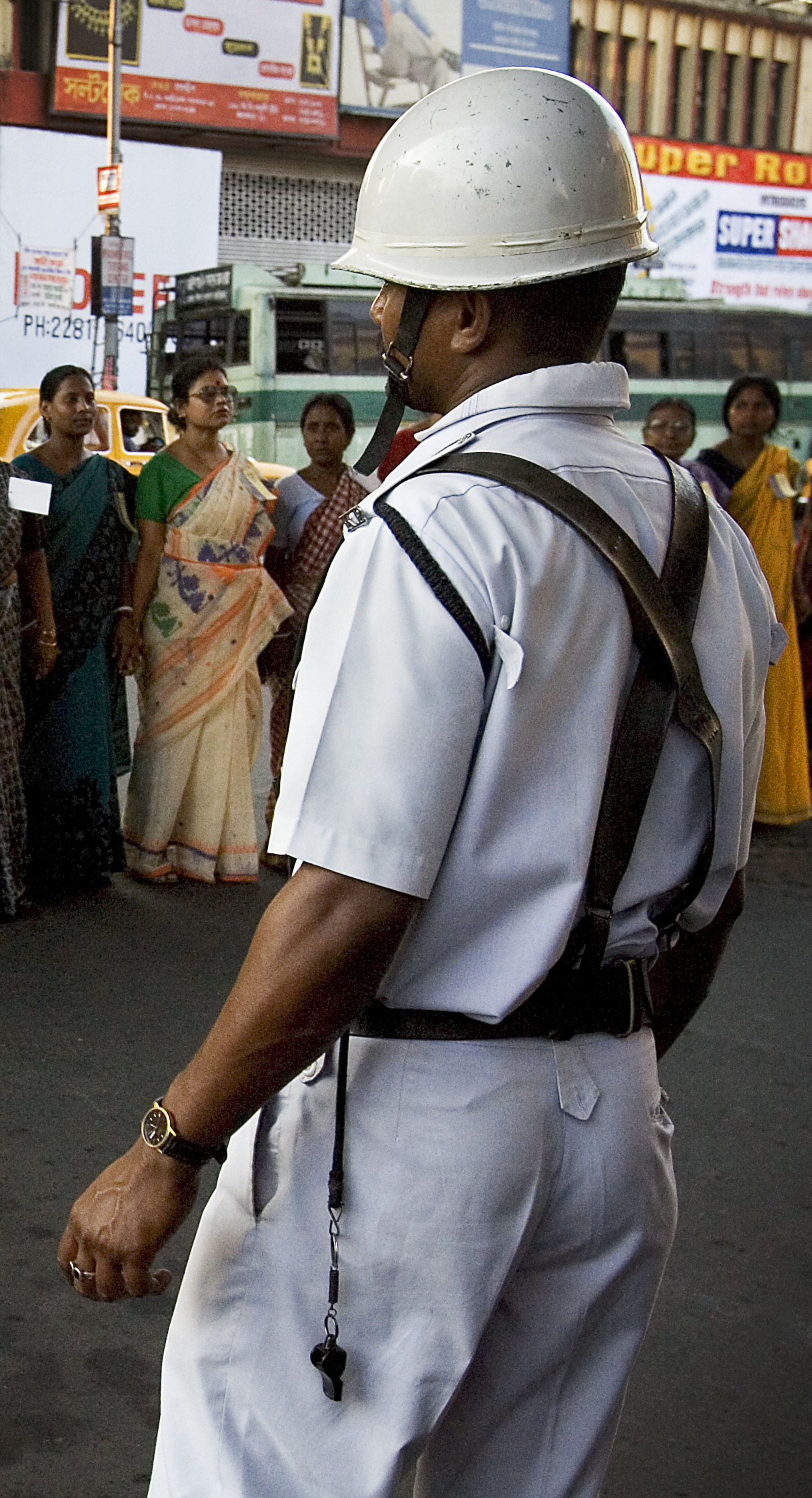 """Policeman facing women in a protest march, Calcutta Kolkata India"" Photo by: Jorge Royan"