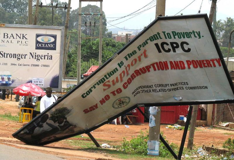 "Anti-Corruption Sign, ""Corruption is the parent to poverty,"" Jos, Nigeria, Photo by Mike Blyth"