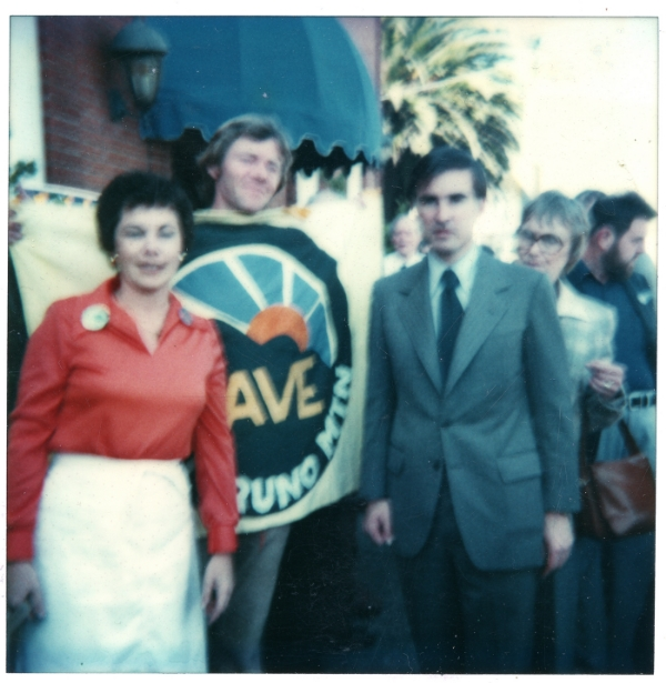 David Schooley holding sign with Jerry Brown on his right