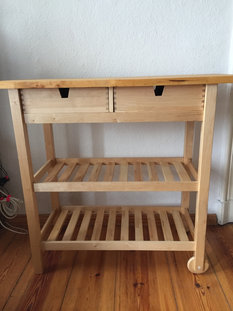 SOLD - Birch Wood Kitchen Cart – Ikea FÖRHÖJA Servierwagen. Gently Used, Very Good Condition. Butcher Block top was covered – clean, no scratches - Was Not used for cutting food on. Has Two Drawers, Two Shelves, and Wheels on one side. Can face either direction (drawers work either way). One small dent/scratch across one leg. 100 x 43 x 90 cm high. Ikea Price New €99.99 – Asking €50.
