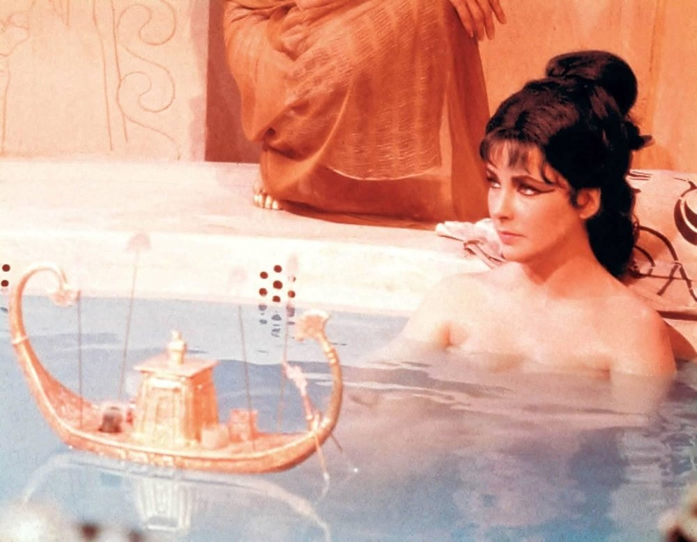 Elizabeth Taylor having a bath in a movie.