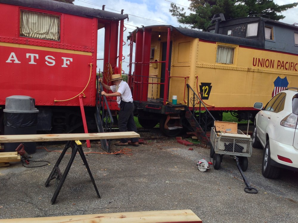 After 47 years of Winter, Spring, Summer and Fall, we're currently in the process of rebuilding the stairs that lead up to each caboose. For the original 2 rows of cabooses (#1-12 and 20-29) we'll be preserving Don Denlinger's original Pennsylvania Dutch-themed railings by constructing the wooden staircase between the railings.
