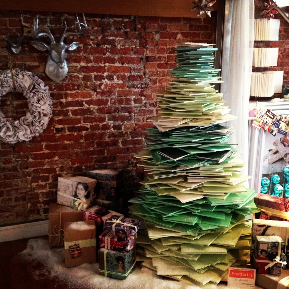 This is a tree that I made entirely out of Shutterfly photo books. The presents below are wrapped with vintage prints of my family and the tags are photoshopped luggage tags.