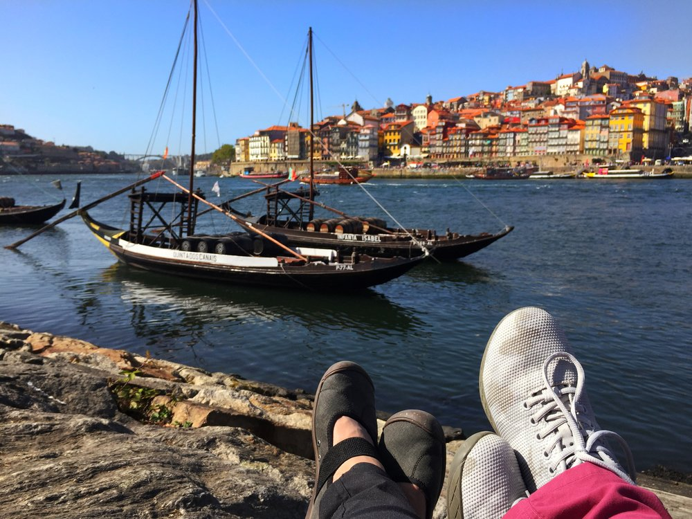 View of Porto from Vila Nova de Gaia. The boats you see pictured here were the traditional boats used to carry Port wine from the Douro Valley where the grapes are grown, downstream to Porto.