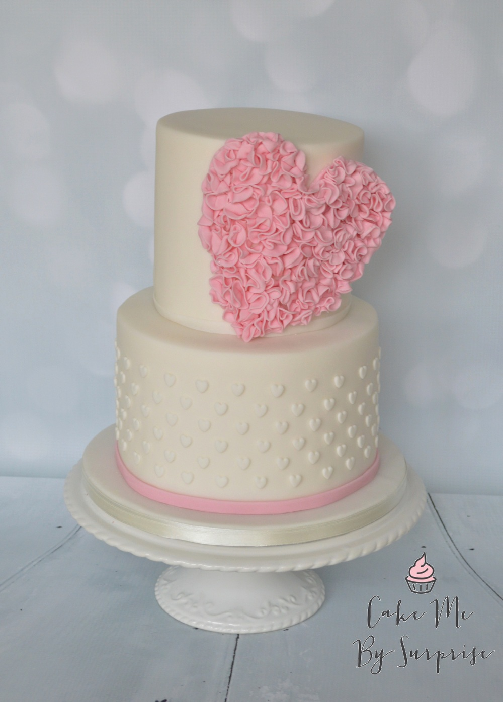 Ruffled Sweetheart A sweet two tier cake complete with statement ruffled heart and tiny white heart embellishments Serves 40 £260