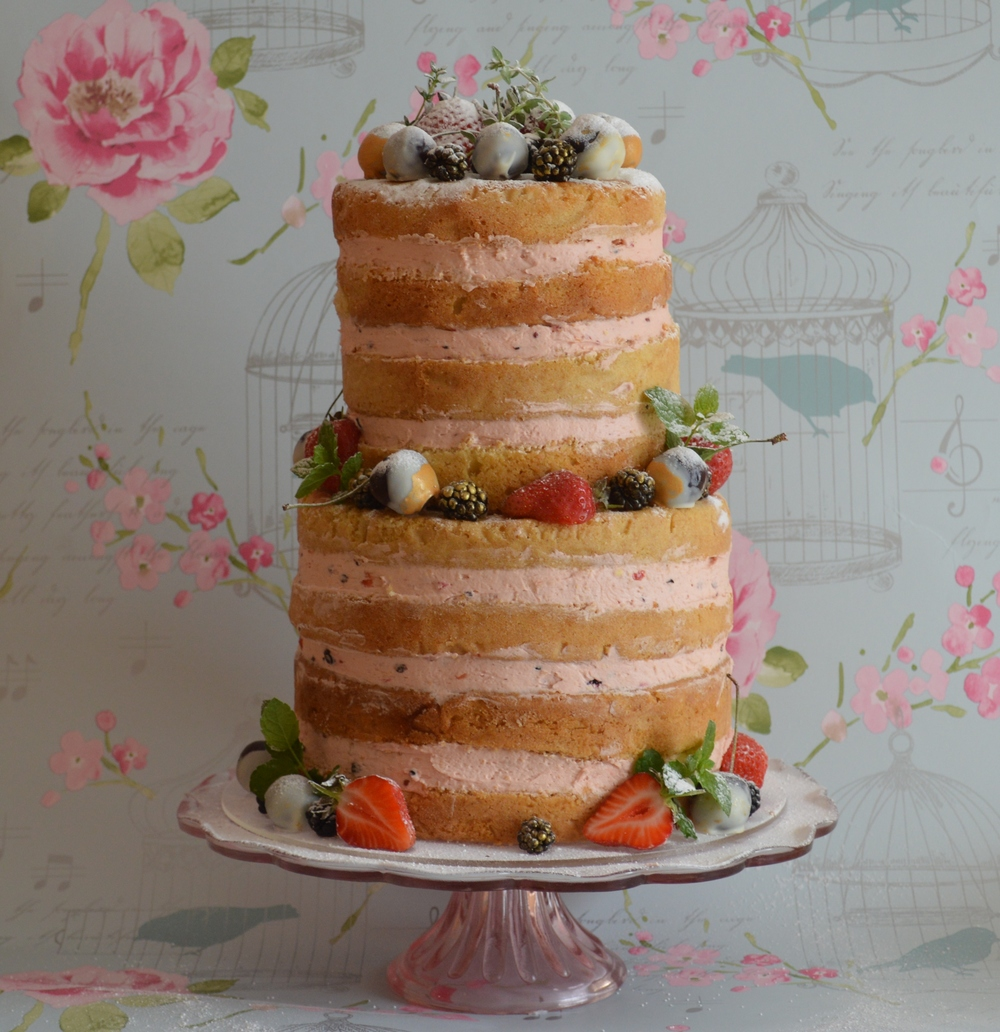 Fruits of the Forest Naked wedding cake complete with cherries and blackberries dipped in edible gold.  With a forest fruits berry buttercream filling Serves 40 £230