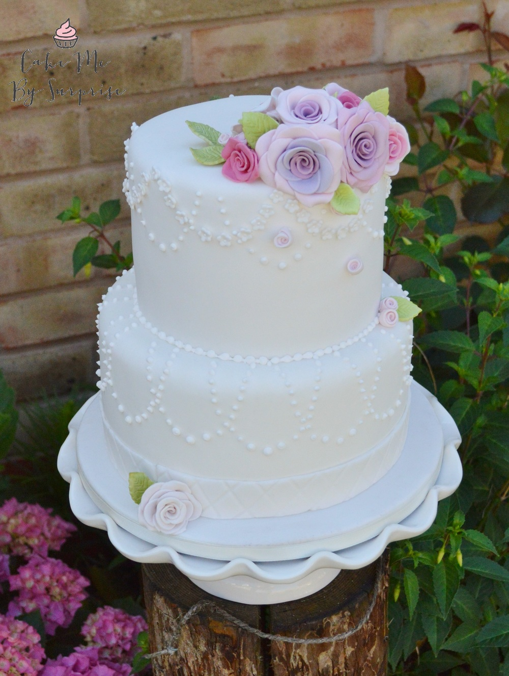Swedish Princess Draped pearl beading, blossoms and carousel roses Serves 45 £200