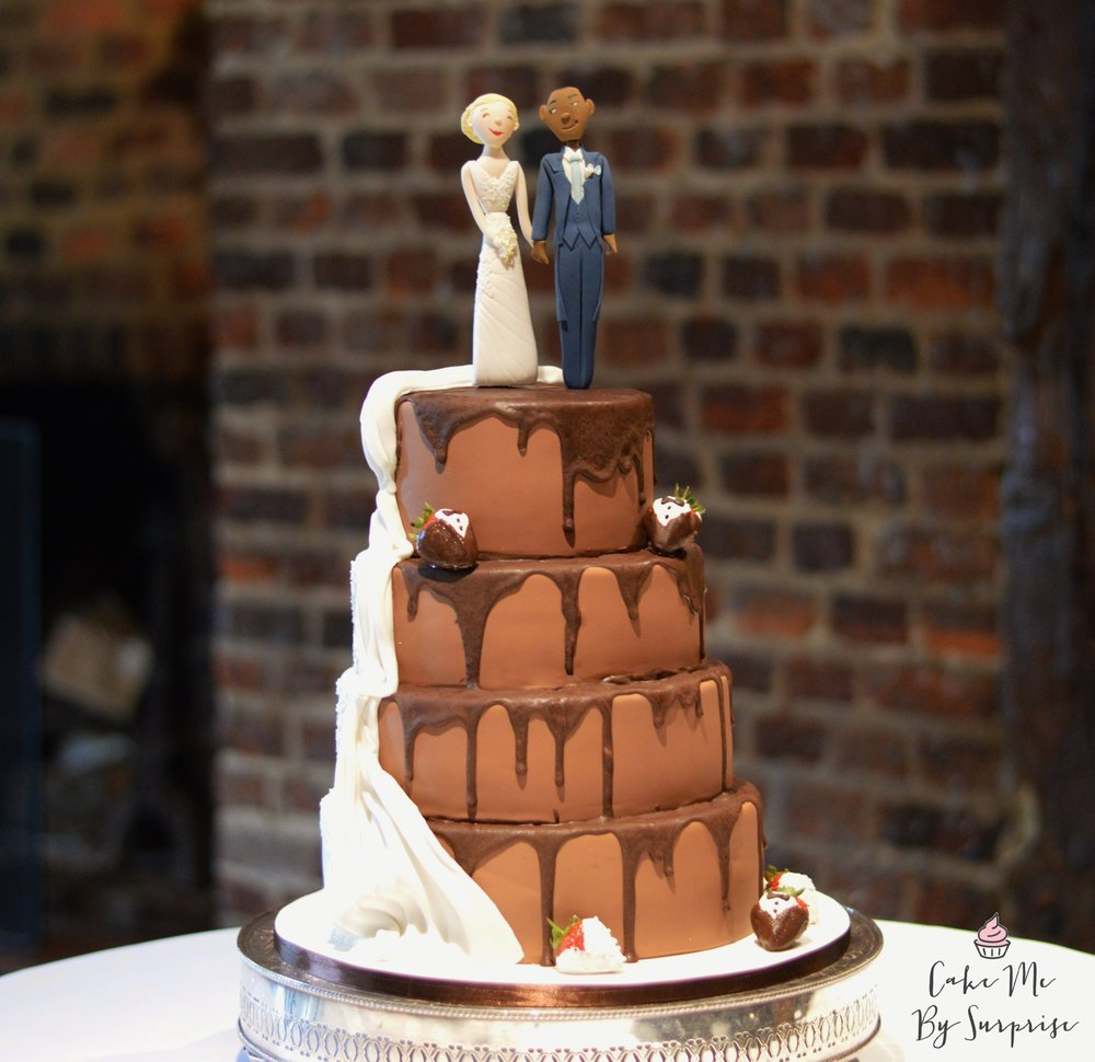 Chocolate Drip Wedding Dress  A very popular design that has been circling the internet in the last few years. Complete with chocolate dipped strawberries. Serves 100 £500* *Not including cake toppers