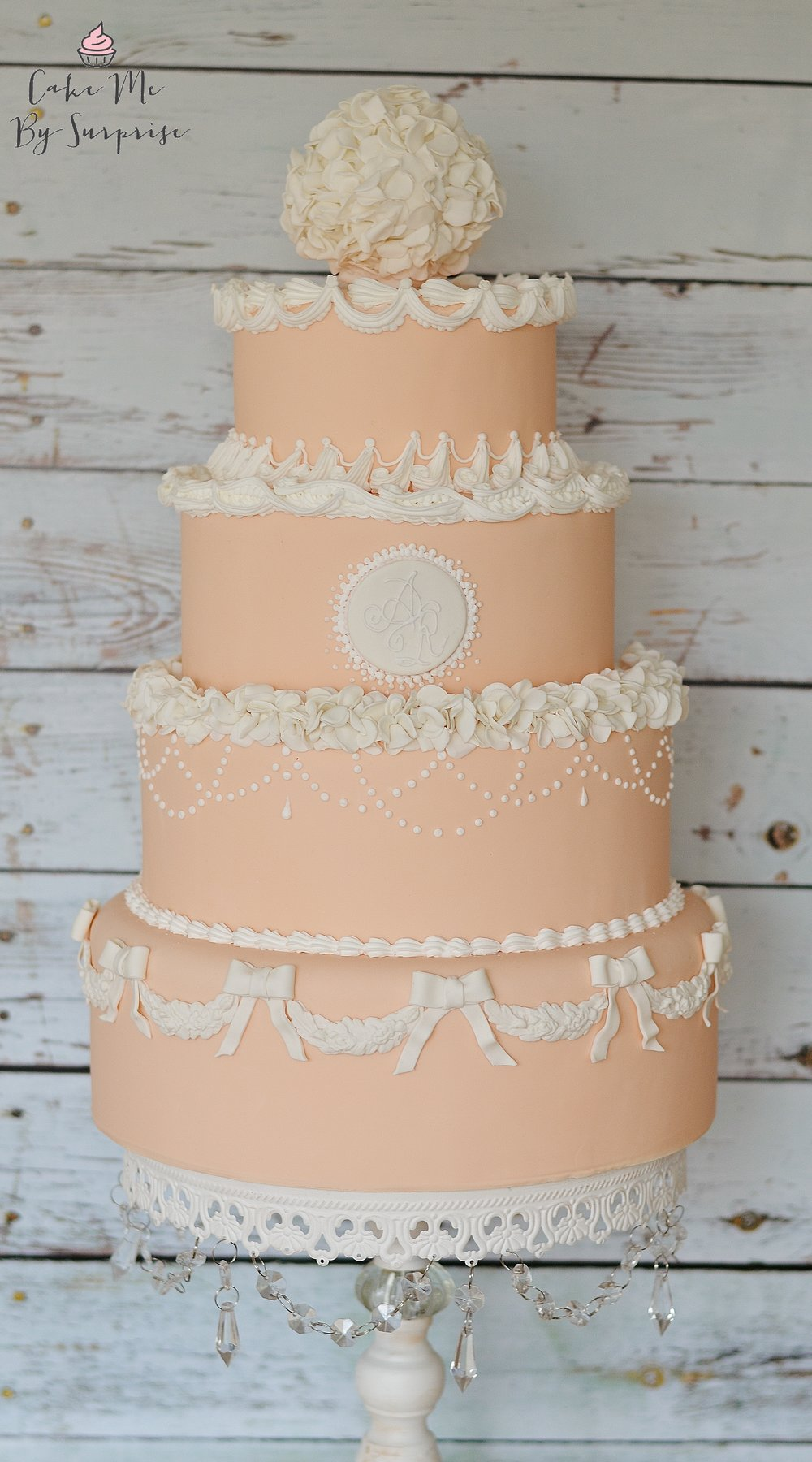 Queen Victoria Inspired Pretty in Peach Inspired by the traditional royal wedding design, this cake features a mix of royal icing piped scrolls and swirls, along side handcrafted sugar bows and ruffles.  Serves 200+ £815