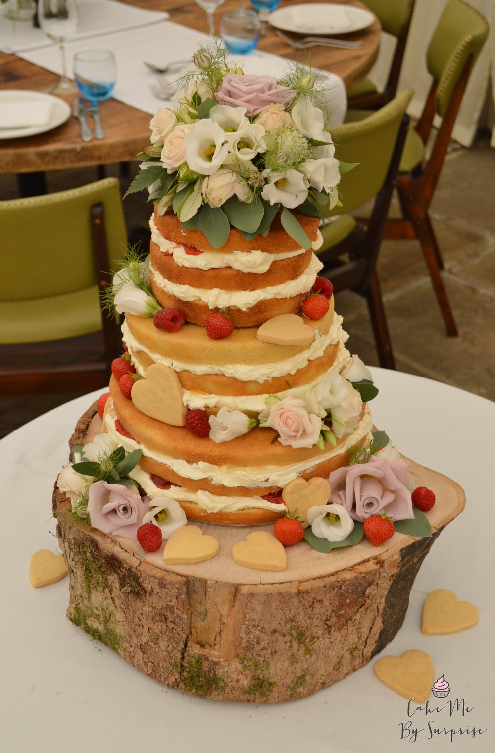 naked wedding cake with biscuit hearts