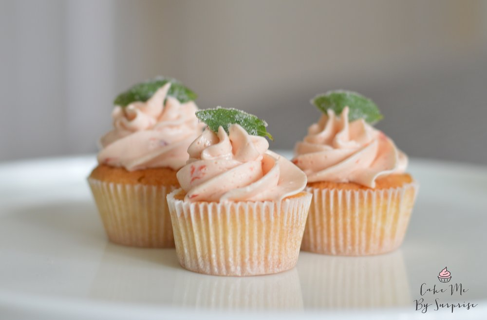 Mini dessert table cupcakes Wow your guest with these delicious little bites. Don't be afraid to experiment with flavours. Featured here are vanilla cupcakes with fresh strawberry and basil frosting.  £30.00 per cake (Minimum Order 18)