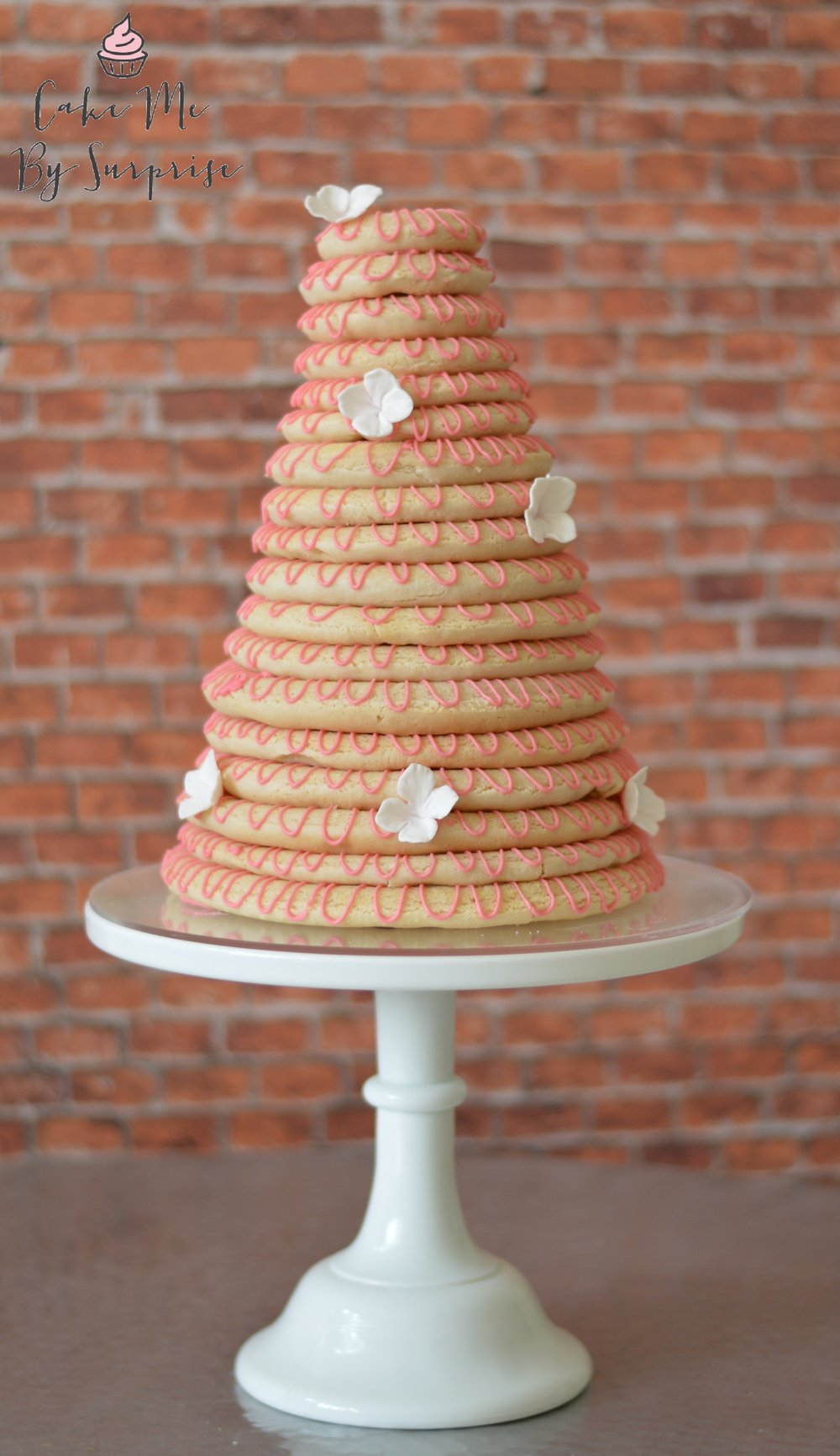 Kransekake A tower of sweet almond biscuit traditionally created for Scandinavian weddings.   £200 minimum order Priced by height ( Please contact us for further details)