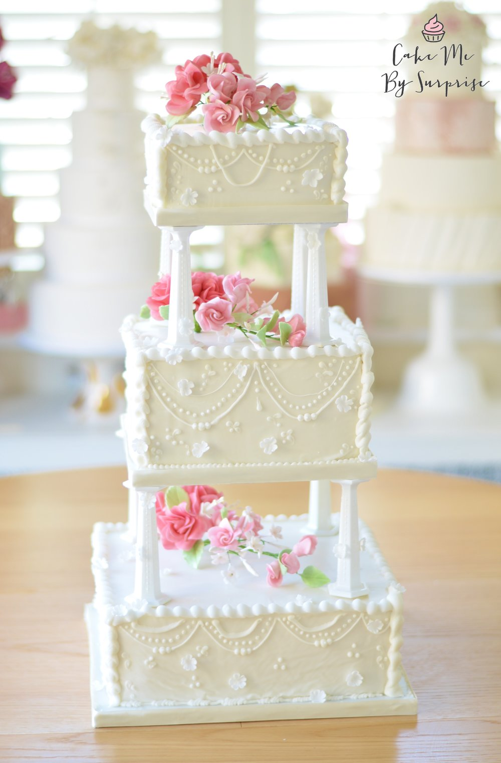 Miriam Three tier 1920's vintage design, named after the Bride herself. A bespoke design finished with ivory royal icing and handcrafted sugar floral sprays. Serves 90+ £500