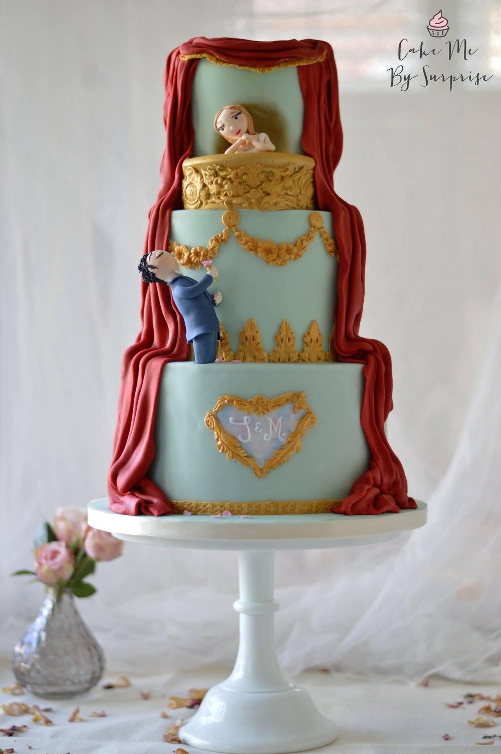 At The Opera Three tier duck egg blue finished wedding cake, inspired by the couples love of the opera. Bespoke design. Serves 130 £500