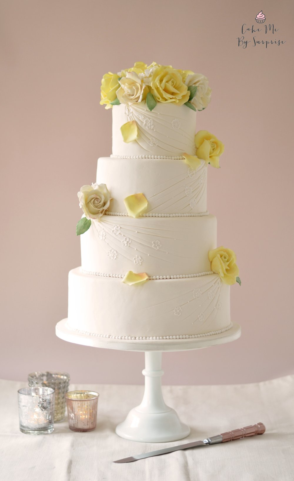 Golden Celebration - Yellow Rose Wedding Cake A four tier elegant wedding cake, finished with handcrafted yellow and white roses. Serves 200 £700