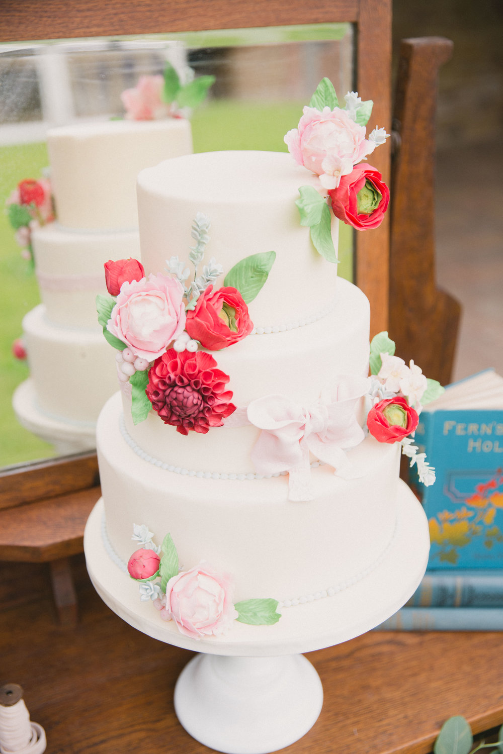 Something Borrowed ( Photography Credit to Rebecca Holiday- Wild Rose Photography and Styling my Vintage Amy Three tier ivory fondant finished wedding cake with vibrant sugar dahlias, ranunculus and pastel pink peonies. Serves 70 £400