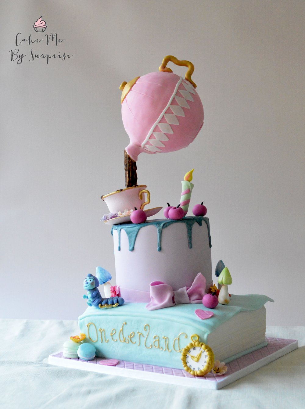 Alice in wonderland gravity defying cake