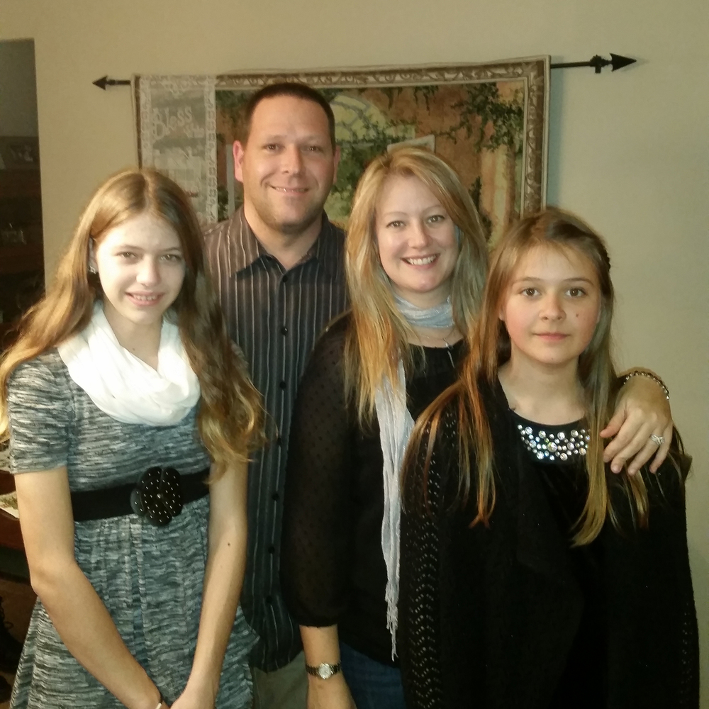 Carmine Pantano, Vice President, with wife Betsy and daughters Allison and Georgia.
