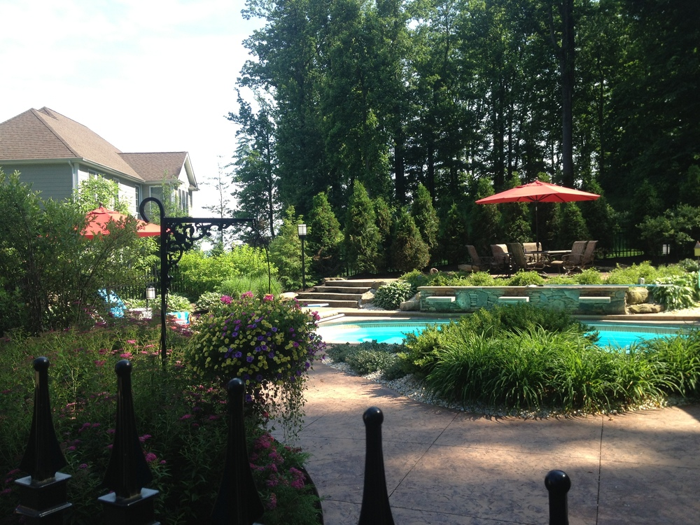 swimming pool patio new concrete pavers and natural stone in greensburg, pa