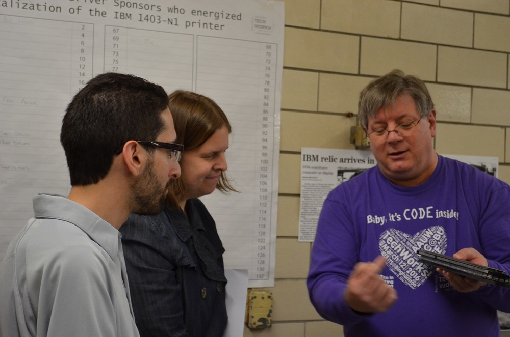 Bob Lusch explains print train to LJ Strumpf Jamie Martin.jpg