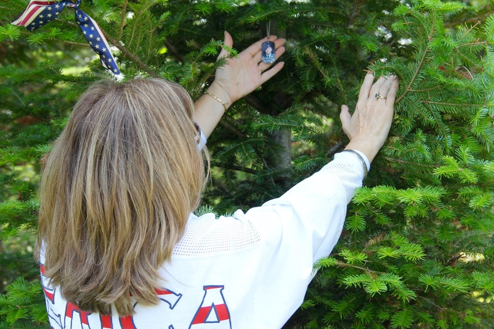 Placing a dog tag on a soldier's Remembrance Tree