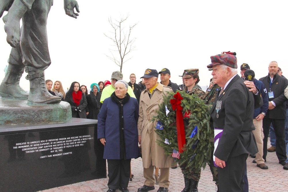 Holocaust Survivor Luna Kaufman (front left), with WW II Veteran Carmine Pecorelli, accepts a wreath for the Liberation Monument in Liberty State Park, NJ during the Wreaths Across America Escort to Arlington National Cemetery in 2015.